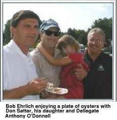Bob Ehrlick enjoying a plate of oysters with Don Statter, his daughter, and       Delegate Anthony O'Donnell.